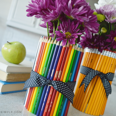 two flower vases wrapped in pencils