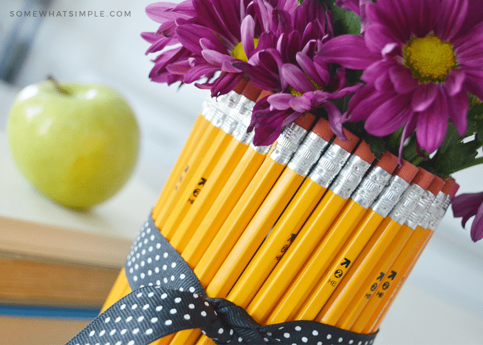 close up of flower vase wrapped in number 2 pencils