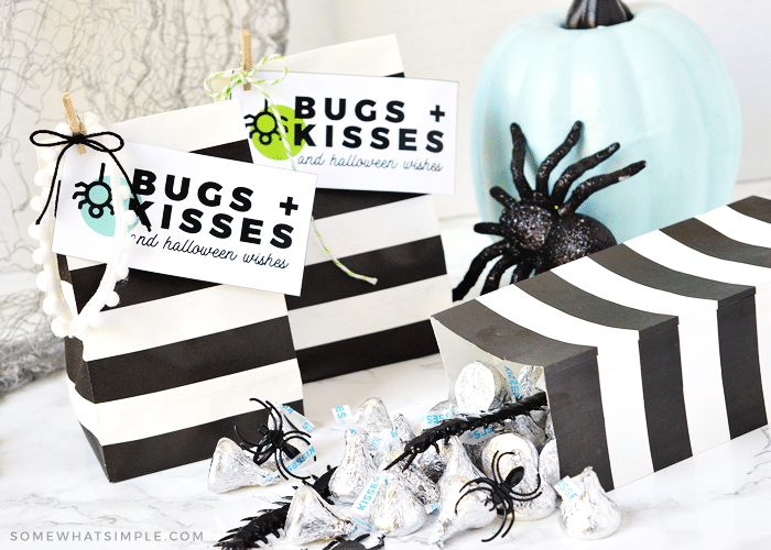halloween gift bags with bugs and kisses tags attached