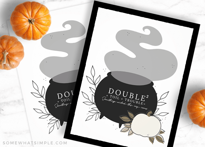 a framed picture that says double double toil trouble