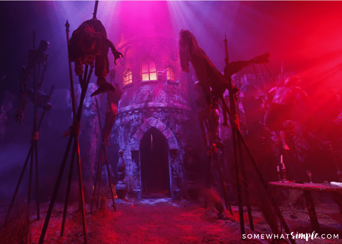 spooky haunted house with purple and pink lights