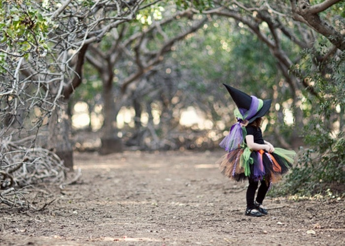 little girl in her halloween costume - halloween photography tips