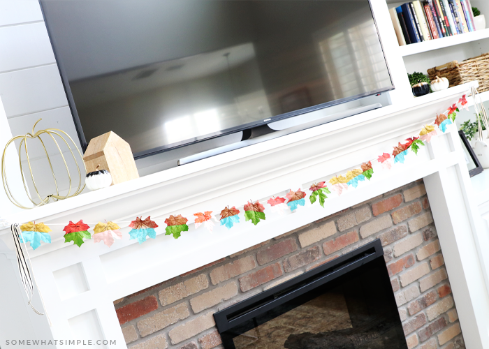 fall leaf banner hung on a mantle