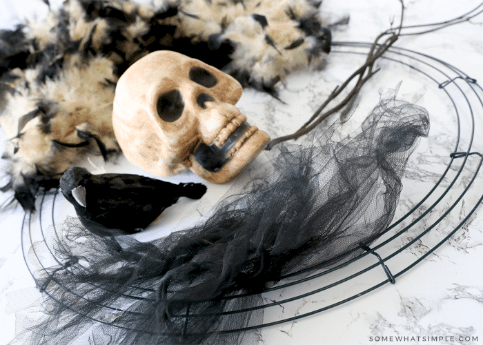 how to make a halloween wreath with a boa and a skull