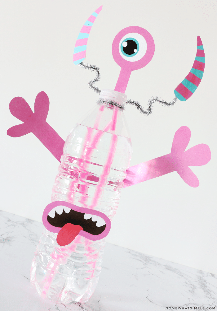 pink monster made from printables, glow sticks and a water bottle