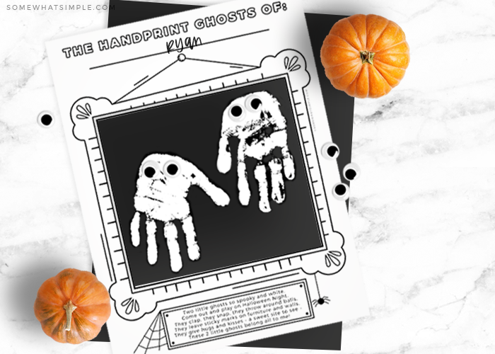 ghost craft for kids with white handprints shaped like a ghost on a black square