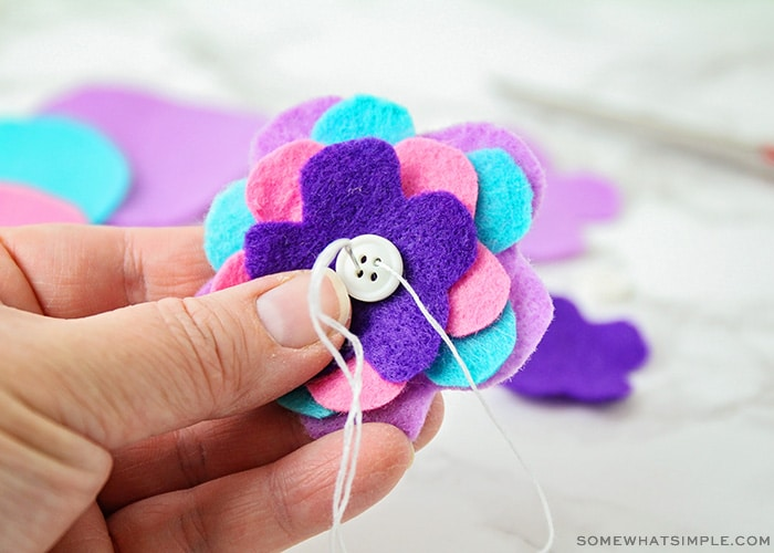 sewing together pieces of felt