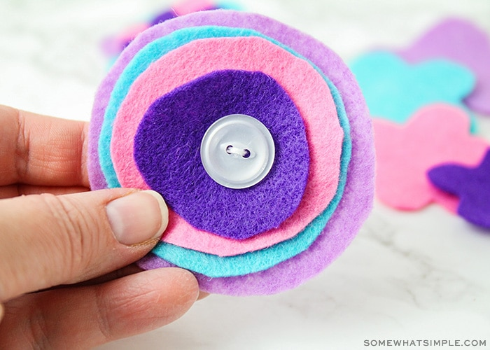 purple, blue and pink pieces of felt that have been sewn together