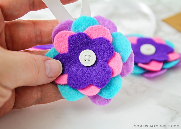 cut felt cirlces stacked on top of each other to make an ornament