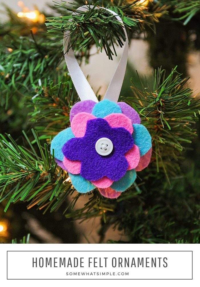 Easy felt ornaments are made with a stack of felt flowers with a button in the center hanging on a christmas tree