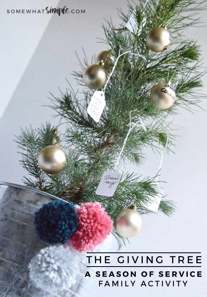 Giving Tree with white tags and gold bulbs