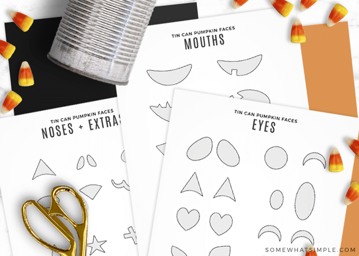 printable pumpkin faces on sheets of paper laying flat with some scissors