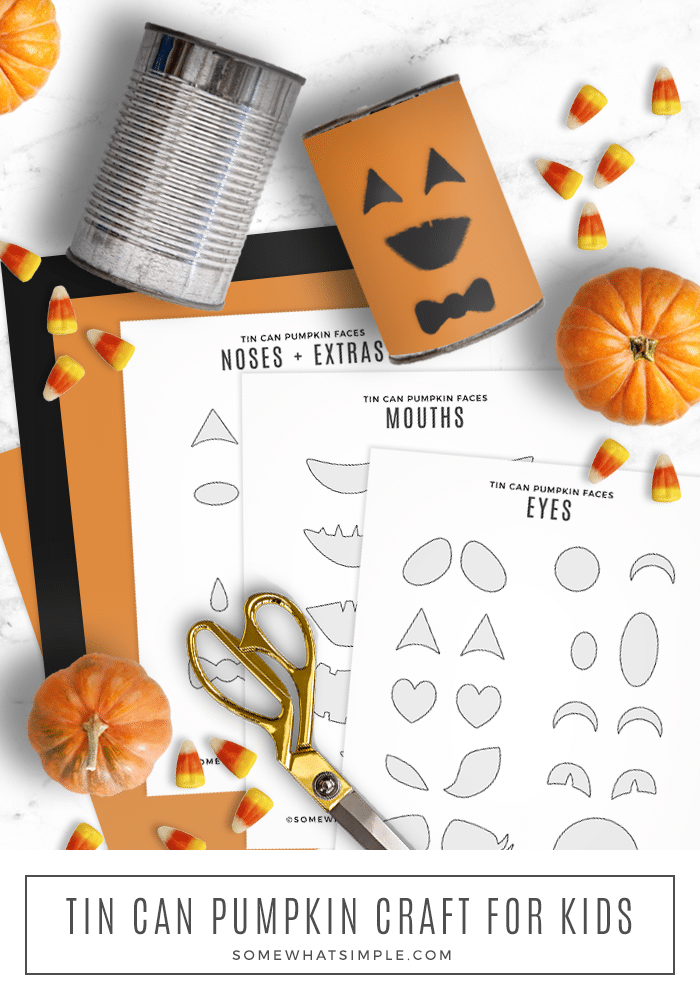 tin can pumpkins laying on the counter with printable faces