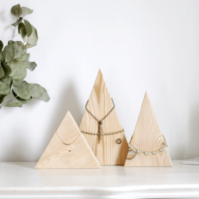 3 wooden triangles holding jewelry
