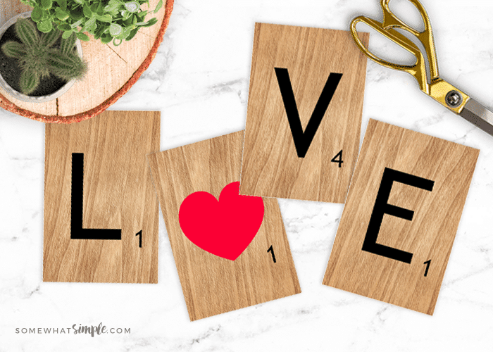 scrabble tiles that spell LOVE laying on a counter for some easy Printable Valentine Decor