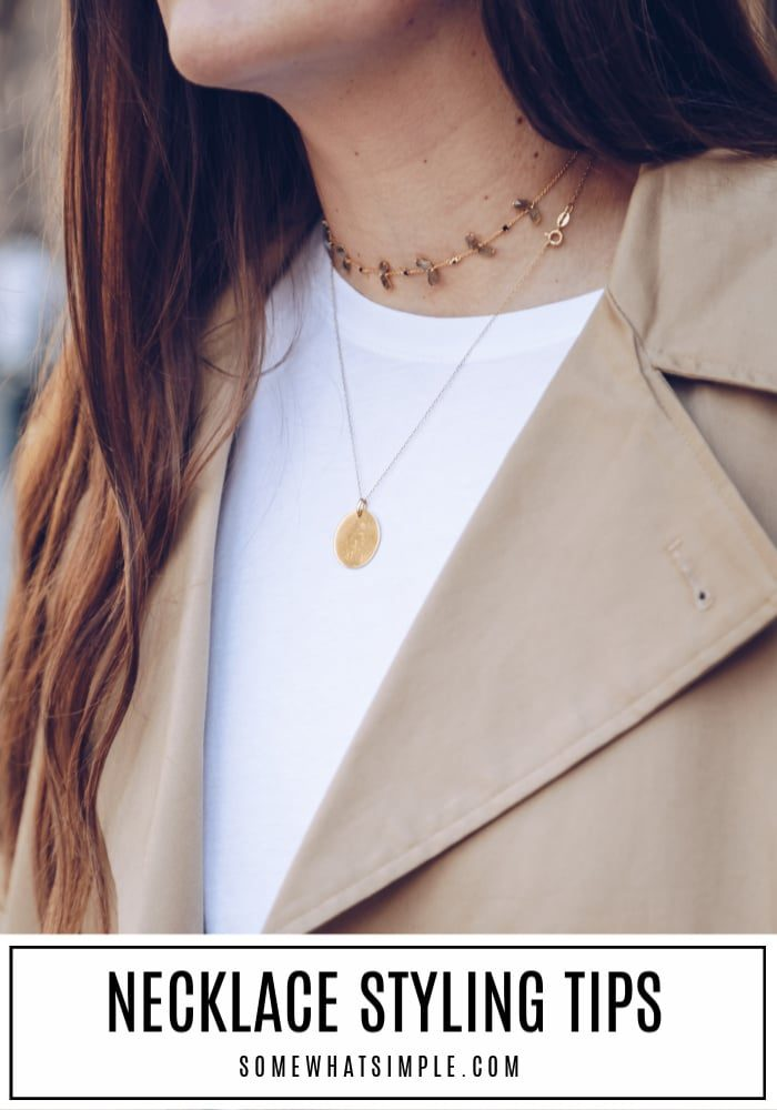 necklace styling tips. pretty lady wearing a white shirt and brown jacket and two gold chains around her neck.