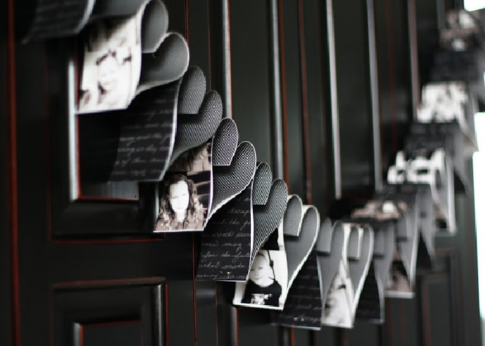 Photos cut into strips and bended into the shape of hearts to make a valentine garland