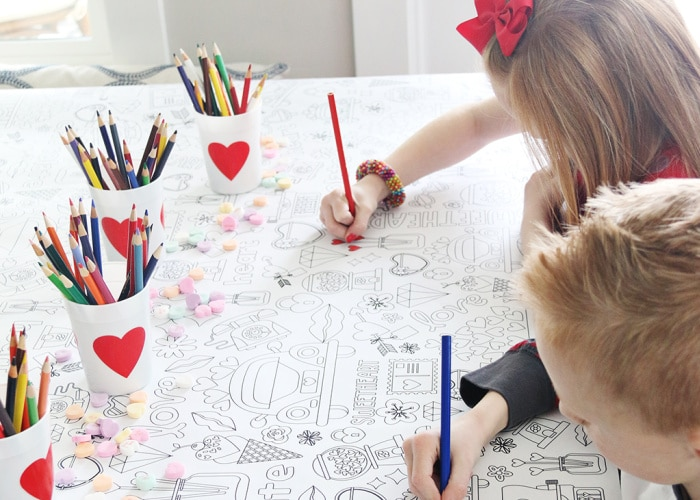 kids coloring on a tablecloth for Valentines Day