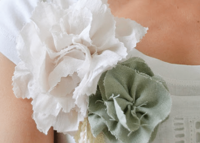 fabric flowers on a woman wearing a white shirt