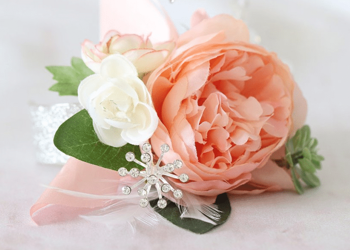 peach and white faux flowers with a diamond star and greenery