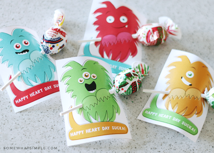 4 printable monster printables holding candy suckers