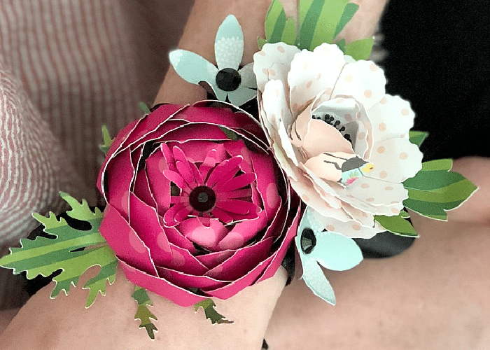 flowers made from paper and put on a wrist corsage