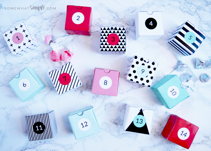 valentine boxes made from paper and numbered 1-14 so you can use them as an advent calendar