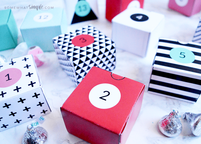 red, white, black and pink paper boxes with numbers on them sitting on a counter
