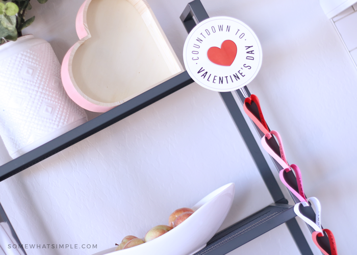heart shaped paper chain countdown hanging on the side of a bookshelf