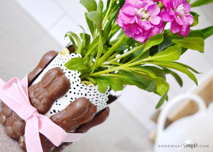 chocolate bunny easter centerpiece with magenta flowers in a white vase