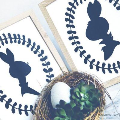 two framed black and white prints of a boy and girl easter bunny