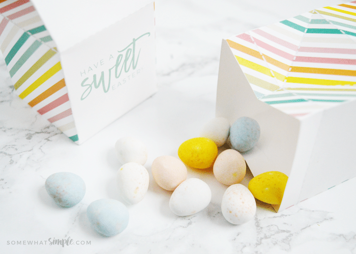paper milk cartons laying on their side with easter candies inside and on the counter