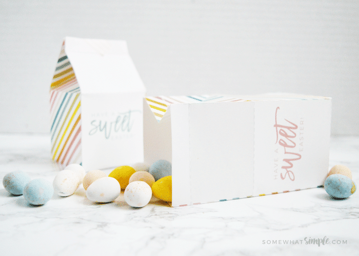 Easter treat box laying on its side with candies coming out of it