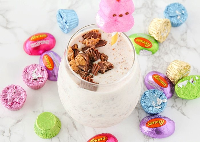 Candy Milkshakes surrounded by a bunch of easter candy on the counter