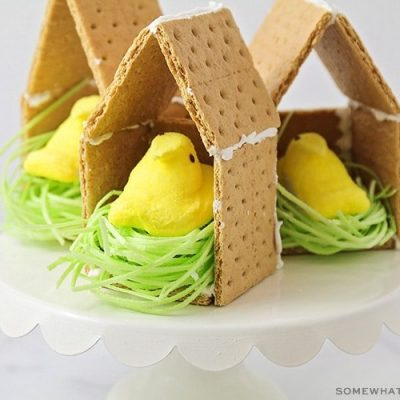 peeps candies inside a graham cracker house with edible easter grass