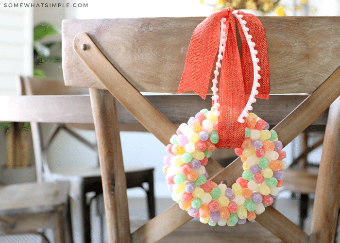 gumdrop wreath hanging from the back of a dining chair