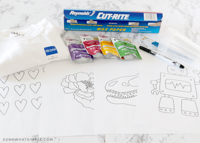 supplies for making a watercolor shirt laid out on the counter