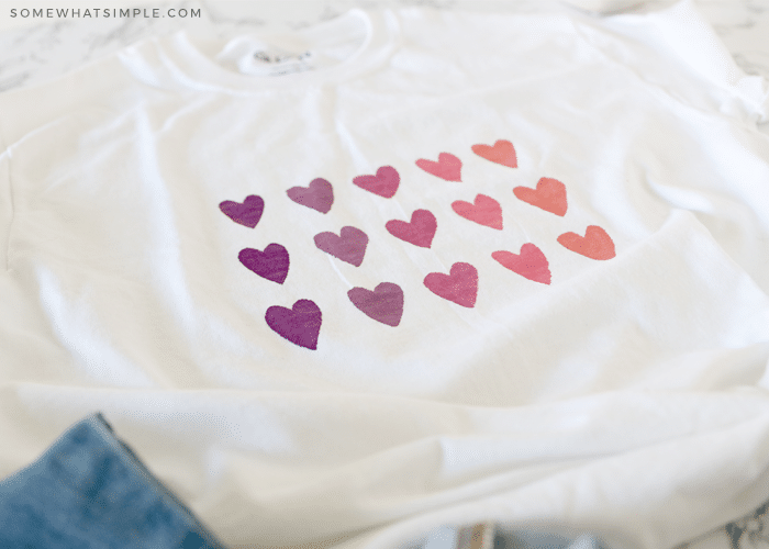 painted hearts on a white shirt