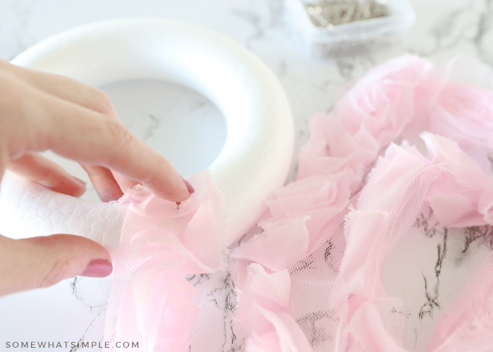 wrapping a wreath form in pink ruffly ribbon