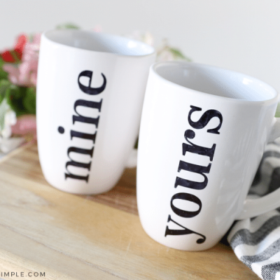 two whit mugs with black lettering