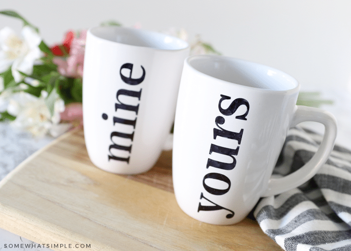 """two white mugs with """"mine"""" and """"yours"""" written on them with sharpie markers"""