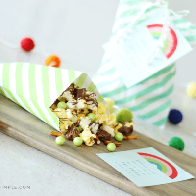 treat bag with candied popcorn and rainbow pom poms for st particks day