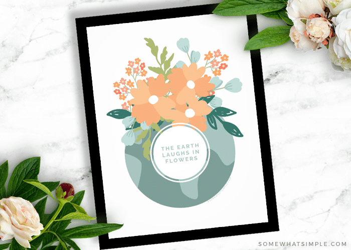 the earth laughs in flowers printable in a black frame