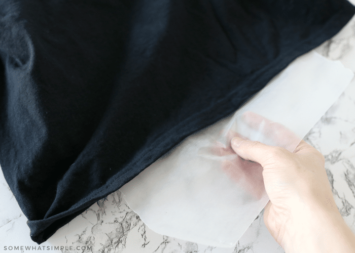 placing a piece of wax paper in between a black shirt