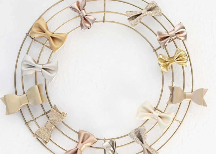 wired wreath form with bows around it