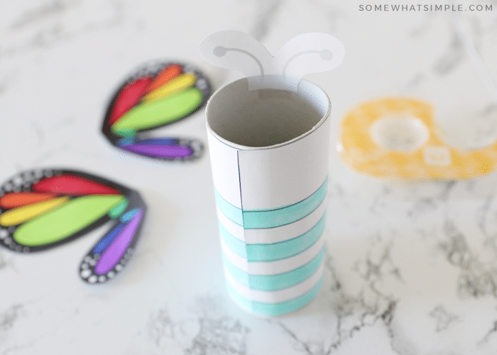 coloring a butterfly craft with markers