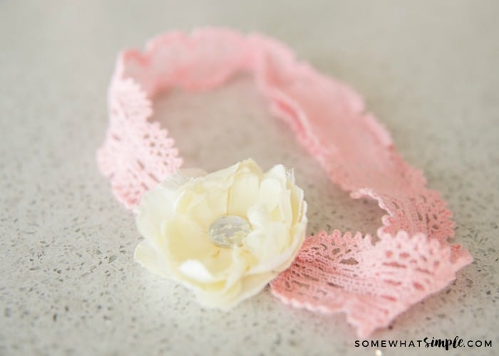 pink headband with a whit flower
