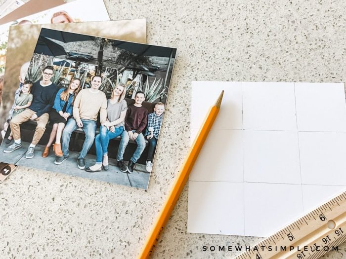using a pencil and ruler to make a 9x9 grid on the back of a photo