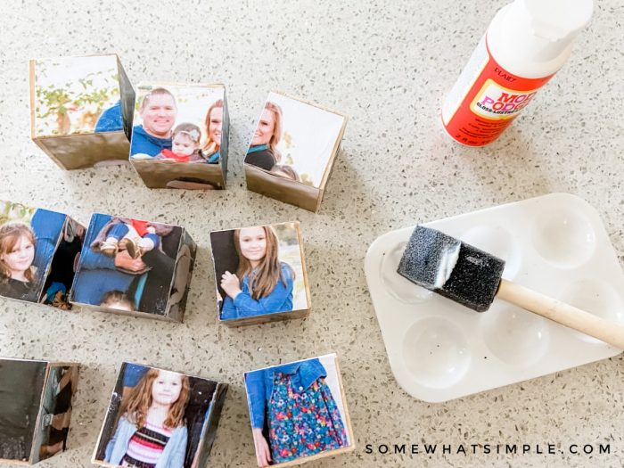 using mod podge to glue photos onto wooden blocks