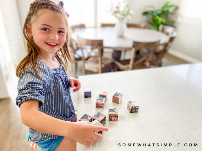 little girl playing with photo block puzzle